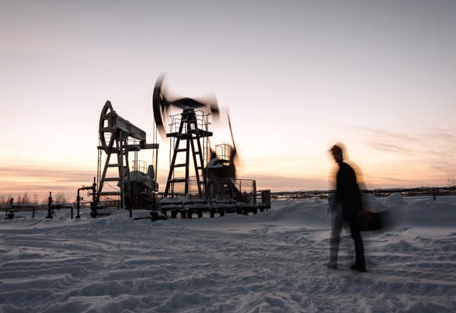 Blurry picture of an oilfield worker. Biggest threats to oilfield jobs 2017 article