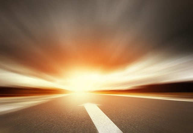 a road ahead with an arrow and horizon. how to restart your career when you've taken a step back