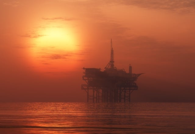 Photo of a red sunset to illustrate a rig abandonment and decommissioning article