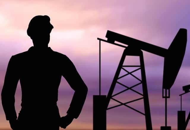 Silhouette of an oilfield worker for article about how it makes you stronger