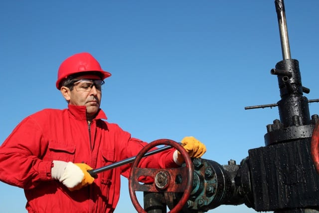 HPHT Well Cementing Challenges articel. Photo of a valve technician
