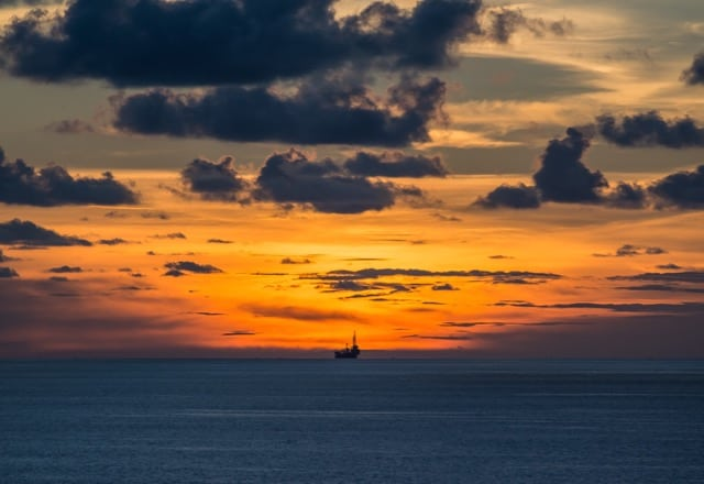 How To Start In Oil and Gas When You Don't Have Experience. Jack up oil rig at sunset in the distance