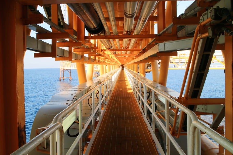 An oil rig walkway to illustrate The 10 Best Petroleum Engineering Schools (USA 2018) article