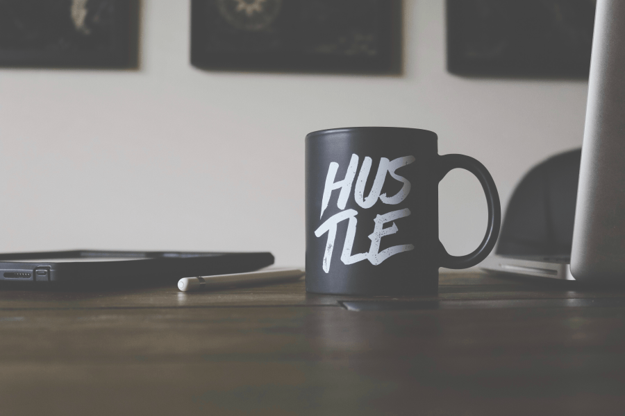 online engineering degree image of a mug saying hustle.