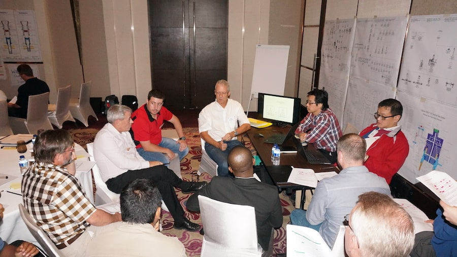 oil and gas training workshop with delegates, charts and laptops
