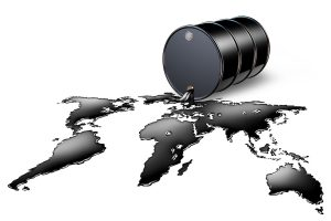 A black drum barrel pouring crude oil as a map of the world: Illustrating an article about how much oil is left in the world.
